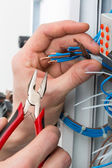 Hands of an electrician — Stock Photo