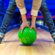 Stock Photo: Beginner aiming to bowling pins