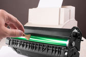 Cleaning printer toner cartridge — Stock Photo