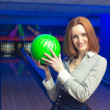 Beautiful woman in a bowling - Stock Photo