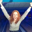 Excited girl in a bowling — Stock Photo