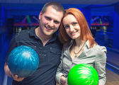 Happy couple in a bowling — Stock Photo