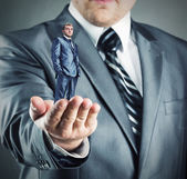 Small businessman in hand — Stock Photo