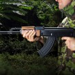 Soldier with rifle AK-47 — Stock Photo #24121637