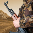 Stock Photo: Soldier holding rifle AK-47