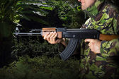 Soldier with rifle AK-47 — Stock Photo