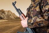 Soldier holding rifle AK-47 — Stock Photo