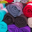 Rolled colorful fleece blankets — Stock Photo #25083207