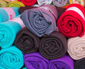 Rolled colorful fleece blankets — Stock Photo