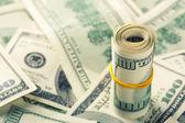 Rolled 100 dollar bills — Stock Photo