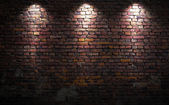 Brick wall with lights — Stock Photo