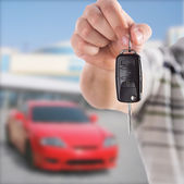 Handing car key — Stock Photo