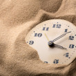 Alarm clock in sand — Stock Photo