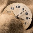 Face of clock in sand — Stock Photo #26854109