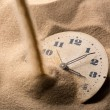 Stock Photo: Face of clock in sand