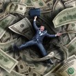 Businessman falling into financial tunnel — Stock Photo #26854139