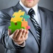 Puzzle house in hand — Stock Photo