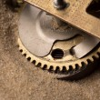 Clock gears in sand — Stock Photo