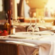 Restaurant table at sunset — Stock Photo #28996223