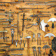 Old tools on the wall — Stock Photo #28996767