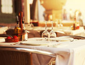 Restaurant table at sunset — Stock Photo