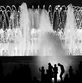 Kids against fountain — Stock Photo