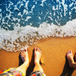 Feet standing on the beach — Stock Photo