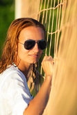 Attractive woman near volleyball net — Stock Photo