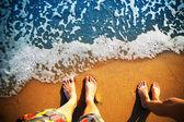 Feet standing on the beach — Stock Photo