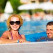 Happy couple in the pool — Stock Photo