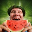 Bizarre man eating watermelon — Stock Photo