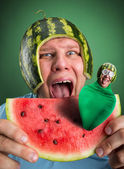 Scared man with watermelon helmet — Stock Photo