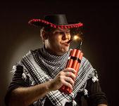 Cowboy mexican firing dynamite by cigar — Stock Photo