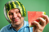 Bizarre man in a helmet from a watermelon — Stock Photo