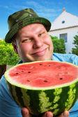 Cheerful farmer with watermelon — Stock Photo
