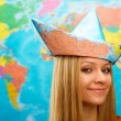 Girl in a hat from map — Stock Photo