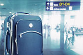 Suitcase at the airport — Stock Photo
