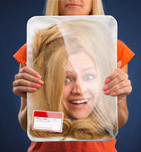 Head in food tray — Stock Photo