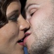 Kissing happy young couple — Stock Photo #3455128