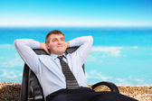 Businessman dreaming about vacation — Stock Photo