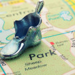 Road map with statuette shoe — Stock Photo