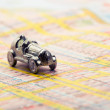 Stock Photo: Old car on map
