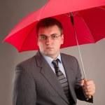 Office worker and umbrella — Stok fotoğraf