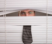 Man and window blinds — Stock Photo