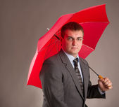 Office worker and umbrella — 图库照片