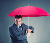 Office worker and umbrella — Stock Photo