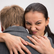Serious businesswoman huging with disgust — Stock Photo #37103343