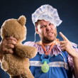Angry man with toy bear — Stock Photo