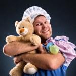 Man and teddy bear — Stock Photo