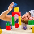Man weared as baby playing — Stock Photo